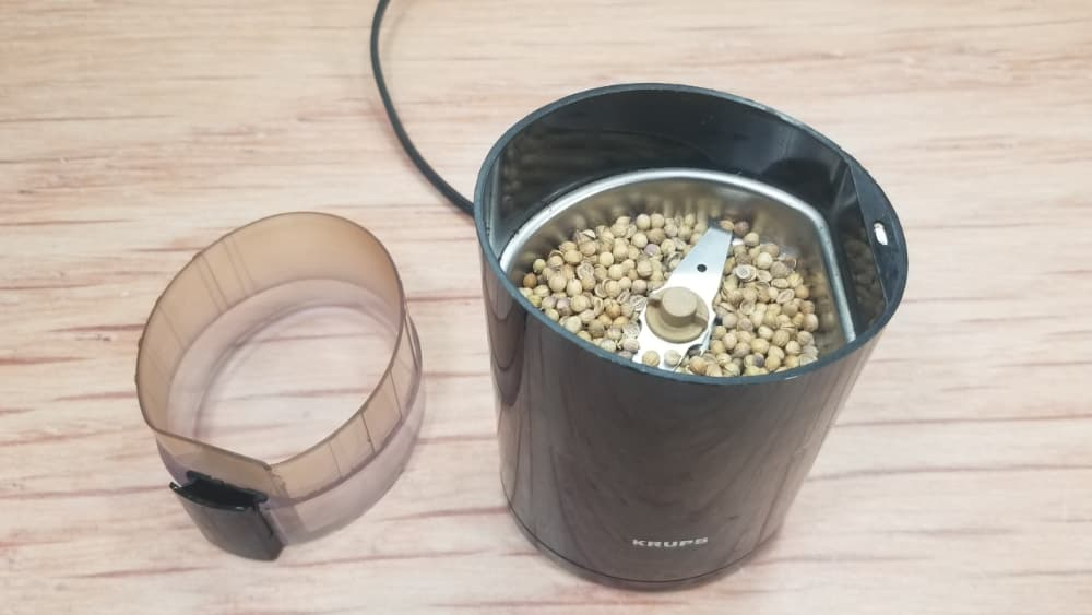 Coriander Seeds in a Grinder